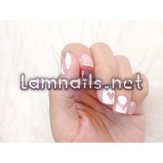 And a mix of cutout shapes rocks even harder in white.   16 Things You Never Realized You Could Do With White Nail Polish